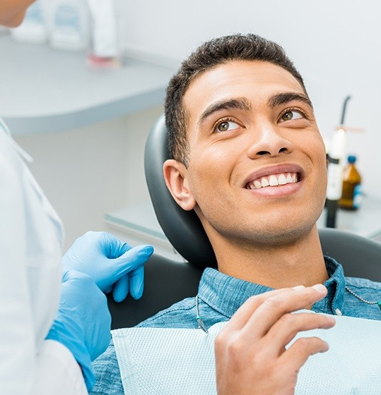 Smiling man in dental chair during dental checkup