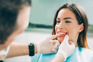 dentist examining patient's teeth